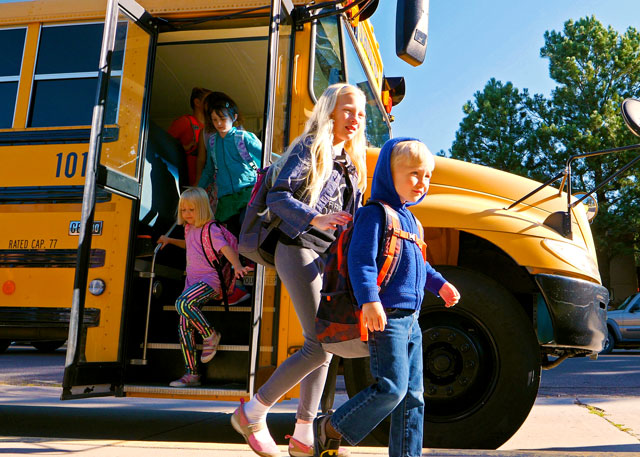 Kids leaving a school-bus